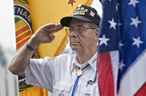 Korean War veteran Jack Keep, 78, of Front Royal salutes during the Presentation of Colors during the Veterans Tribute Thursday morning at the Shenanddoah County Fair.  Rich Cooley/Daily